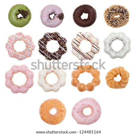 An overhead view fourteen different donuts isolated on a white background. - stock photo