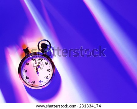An overhead view of a sports stop watch on a blue background with copy space  - stock photo