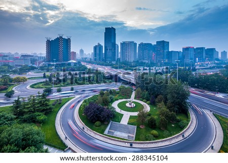 an overpass closeup on the junction at night in beijing, China  - stock photo