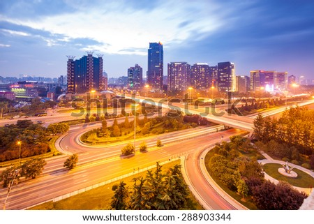 an overpass closeup on the junction at night in beijing, China