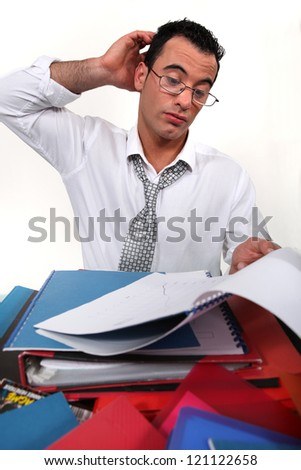 An overwhelmed businessman. - stock photo