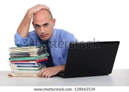 An overwhelmed executive. - stock photo