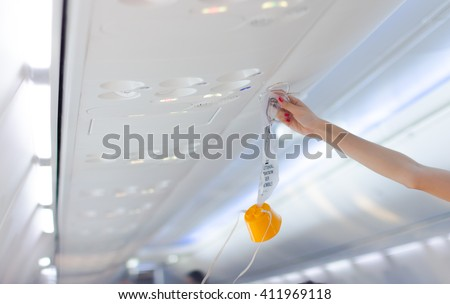 an oxygen mask on the plane.selective focus, Soft focus . - stock photo