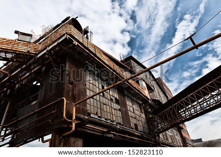 an ruined metallurgical firm's exterior facade - stock photo