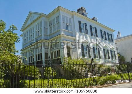 An 1800's era South Battery street Single House style of architecture in Charleston, South Carolina. - stock photo