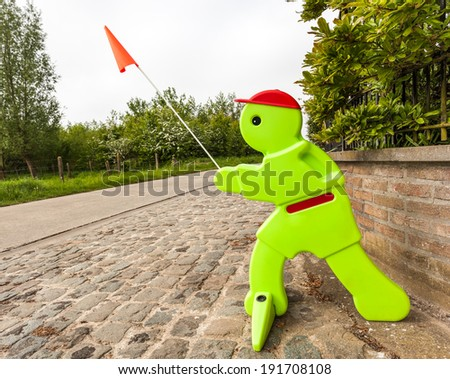 an sign doll for driving slow on the street - stock photo