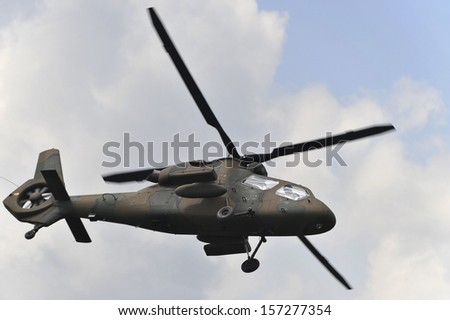 An spotter helicopter in flight - stock photo