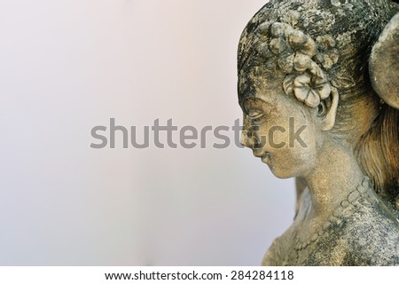 An Statue angel ancient symbol old face . - stock photo