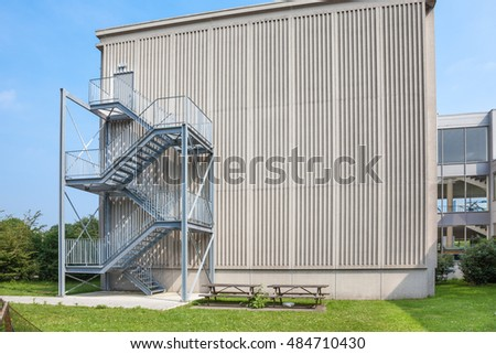 an tall building there is an emergency staircase