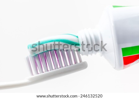 an toothbrush with toothpaste with green and white colors - stock photo