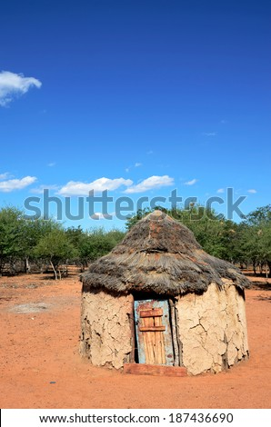 An traditional african hut belonging to the people of the himba tibe in namibia - stock photo