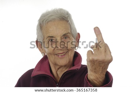 an ugly old woman making hand gesture - stock photo
