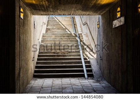 An underground staircase in Stockholm - stock photo
