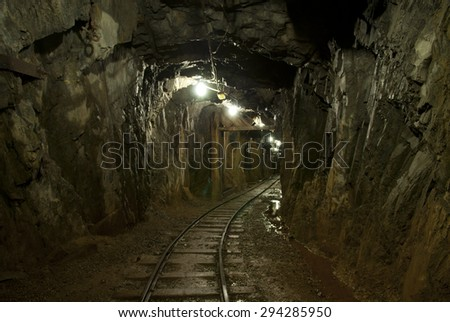an underground tunnel in a copper mine - stock photo