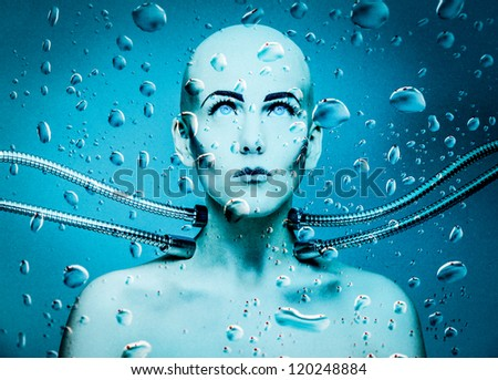 an underwater robot girl connected with metal cables - stock photo