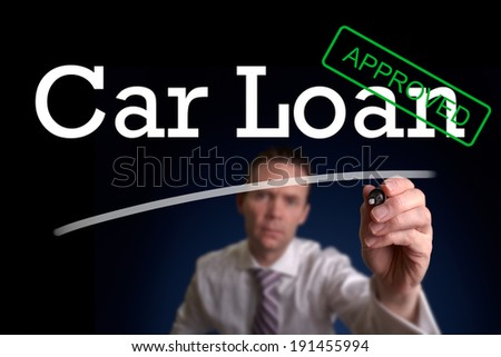 An underwriter writing Car Loan approved on a screen. - stock photo