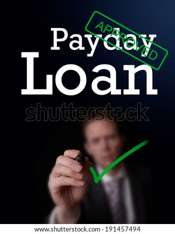 An underwriter writing Payday Loan approved on a screen. - stock photo