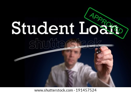 An underwriter writing Student Loan approved on a screen. - stock photo
