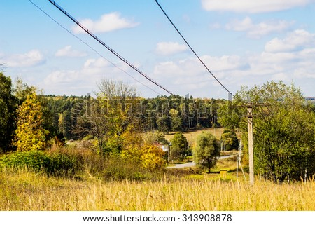 An undulating landscape with transmission line in the country. Image with selective focus