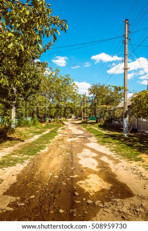 An unpaved road in a remote village in Eastern Europe (republic of Moldova)