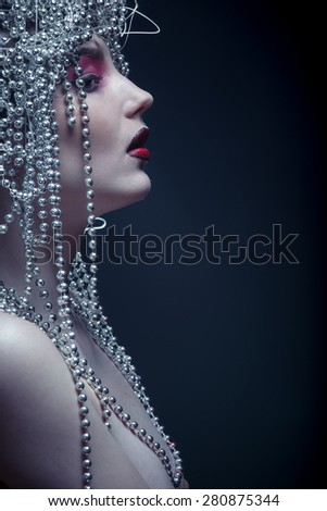 An unusual portrait of a girl fashionable image - stock photo