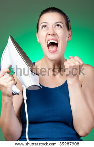 An upset young woman overwhelmed by housework. - stock photo