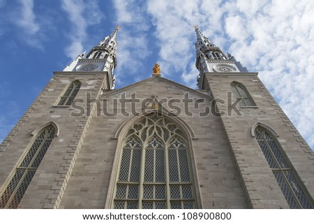 An upward view of the front of  Notre Dame Cathedral Basilica in Ottawa. Ontario. - stock photo