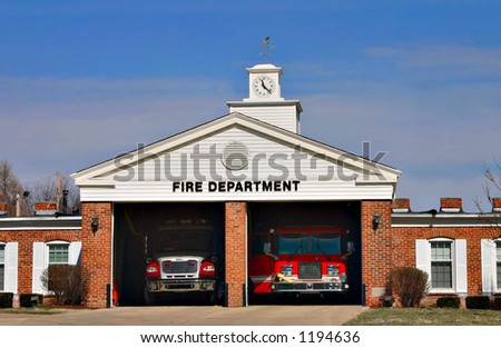 An urban fire station ready to go - stock photo
