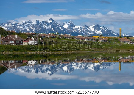 An Ushuaia view with the reflection in the water - stock photo