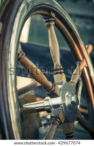 an vintage wheel for a sail boat with a texture applied - stock photo