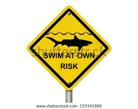 An warning sign isolated on white with shark symbol and words swim at own risk, Use caution when swimming because sharks are present  - stock photo