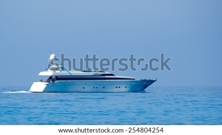 An yacht at Egremni Beach, Lefkada Island, Ionion Sea, Greece. Egremni Beach, Lefkada Island, Ionion Sea, Greece. Beautiful summer on the yacht at Egremni Beach in Lefkada Island, Ionian Sea, Greece - stock photo