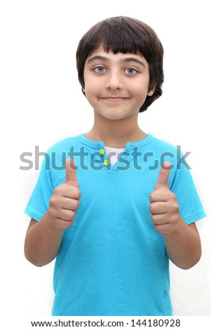 An 8 year old boy with both thumbs up - stock photo