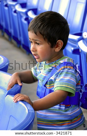 An young Indian kid engossed at a theatre - stock photo