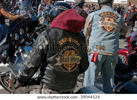 ANACORTES, WA - SEPTEMBER 27: Two unidentified religious bikers participate in the 28th annual Oyster Run large motorcycle run in the Pacific Northwest on September 27, 2009 in Anacortes, WA.
