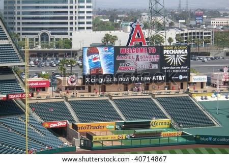 ANAHEIM - APRIL 26: Early arriving fans stroll under the giant scoreboard as they await a spring contest at Angels Stadium of Anaheim on April 26, 2007 in Anaheim, California. - stock photo