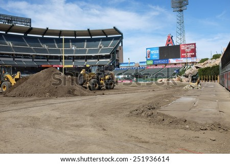 ANAHEIM, CA - FEBRUARY 11, 2015: Angel Stadium of Anaheim field cleanup. Workers remove dirt from inside Angel Stadium after the Motocross and Monster Truck Series. - stock photo