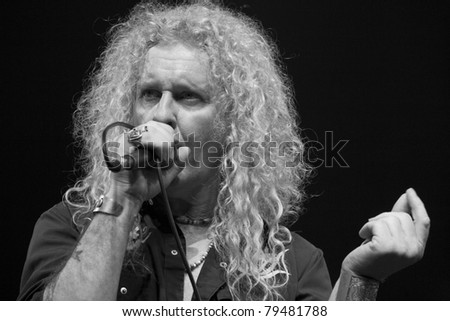 ANAHEIM, CA - JUNE 18: David Montgomery of Led Zeppelin tribute band, Led Zepagain, portrays Robert Plant here, while singing his heart out to fans at The Grove in Anaheim, CA on June 18, 2011. - stock photo