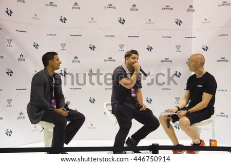 Anaheim, CA - June 23: Landon Dowlatsingh (R) and Michael McCrudden (M) answer questions at the 7th annual VidCon conference at the Anaheim Convention Center in Anaheim, California on June 23, 2016
