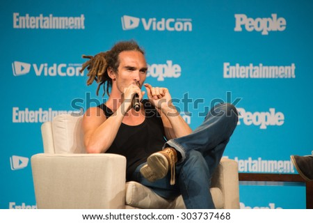 Anaheim, CA - June 23: Louis Cole answers questions for People Magazine at VidCon 2015 at the Anaheim Convention Center in Anaheim, California on June 23, 2015 - stock photo