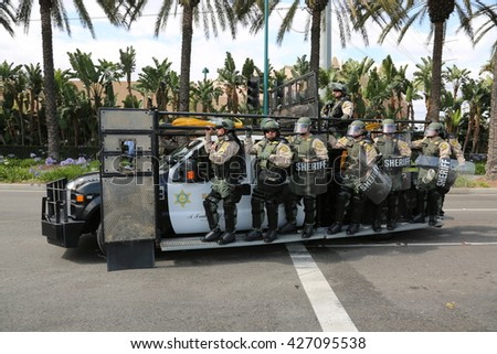 ANAHEIM CALIFORNIA, May 25, 2016: Police in riot gear arrive protect both supporters and protesters from each other during the Republican Nominee Donald J. Trump Rally Anaheim 5.25.2016  - stock photo