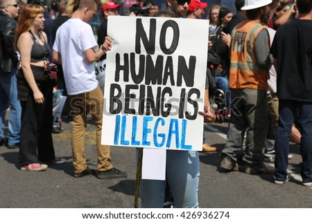 ANAHEIM CALIFORNIA, May 25, 2016: Protesters yell argue with supporters, wave signs and cause trouble for the police at the Republican Presidential Candidate Donald J. Trump rally 5.25.2016  - stock photo
