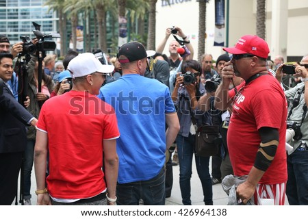 ANAHEIM CALIFORNIA, May 25, 2016: Supporters, wave signs and show their support for Presidential Candidate Donald J. Trump at the Anaheim Convention Center rally on.  5.25.2016  - stock photo