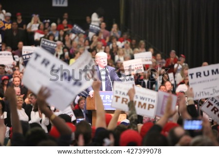 ANAHEIM CALIFORNIA, May 25, 2016: Thousands of Supporters and Fans wave signs and take cell phone pictures of Republican Nominee Presidential candidate Donald Trump as he speaks at his campaign event - stock photo