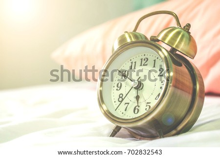 analog alarm clock in the bedroom. morning