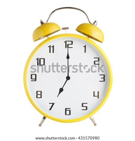 Analog alarm clock showing seven o'clock isolated on white background - stock photo