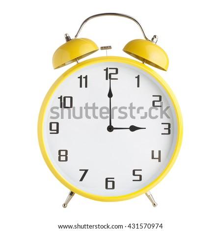 Analog alarm clock showing three o'clock isolated on white background - stock photo