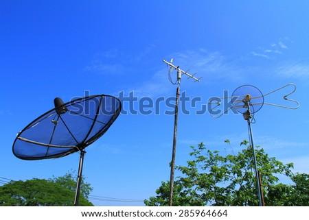 Analog antennas VS modern analog satellite with blue sky, Thailand - stock photo