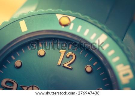 analog  clock set to twelve - stock photo