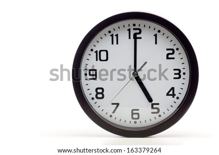 Analog clock with black frame, showing 5 o'clock as typical end of office hours. Cutout, studio shot, isolated on white background. - stock photo